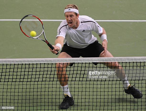 Sweden's Jonas Bjorkman returns the ball during his doubles final match against compatriots Johan Brunstrom and Mickael Ryderstedt at the Stockholm...