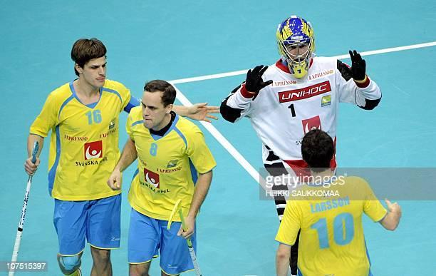 Sweden's KarjJohan Nilsson Jimmy Lindblom goalkeeper Patrik Jansson and Mathias Larsson celebrate after winning 23 against Switzerland during their...