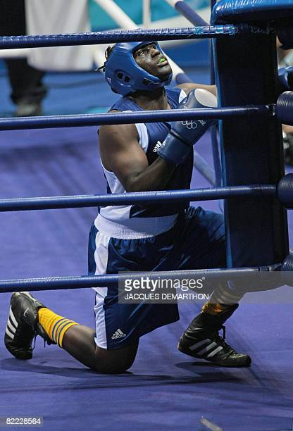 Sweden's Kennedy Katende prays before his match against Russia's Artur Beterbiev during the 2008 Olympic Games Light Heavyweight boxing bout on...