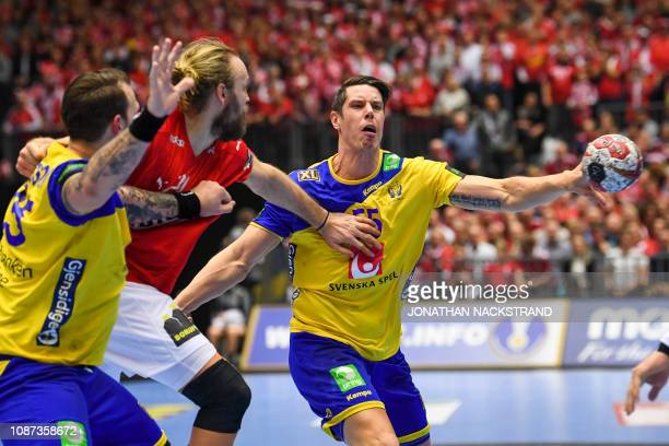 Sweden's Kim Andersson vies with Denmark's Henrik Mollgaard Jensen during the IHF Men's World Championship 2019 Group II main round handball match...