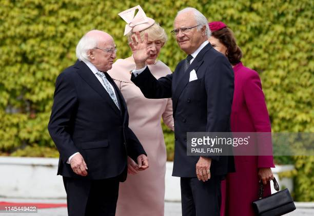 Sweden's King Carl XVI Gustaf and Queen Silvia are greeted by Ireland's President Michael D Higgins and his wife Sabina, at Pheonix Park in Dublin on...