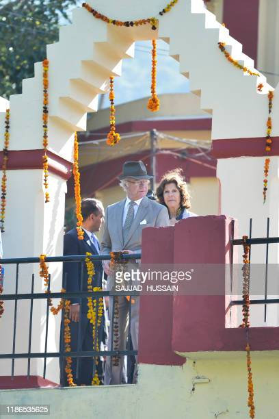 Sweden's King Carl XVI Gustaf and Queen Silvia arrive to attend a Ganga Arti Puja a prayer service on the banks of the Ganga river in Rishikesh on...