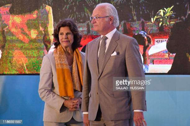 Sweden's King Carl XVI Gustaf and Queen Silvia arrive to inaugurate the Sarai sewage treatment plant in Haridwar on December 5 2019