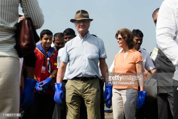 Sweden's King Carl XVI Gustaf and Queen Silvia arrive to participate in a beach cleanup project a the Versova Beach in Mumbai on December 4 2019