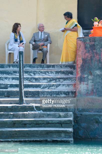 Sweden's King Carl XVI Gustaf and Queen Silvia attend a Ganga Arti Puja a prayer service performed by two female priests on the banks of the Ganga...