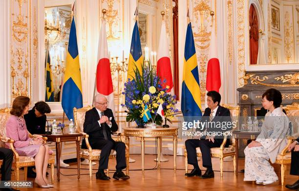 Sweden's King Carl XVI Gustaf and Queen Silvia meet with Japan's Prime Minister Shinzo Abe and his wife Akie at Akasaka Palace in Tokyo on April 25...