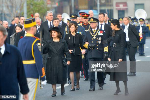 Sweden's King Carl XVI Gustaf and Queen Silvia outside the former Royal Palace in Bucharest on December 16 to attend a military and religious...