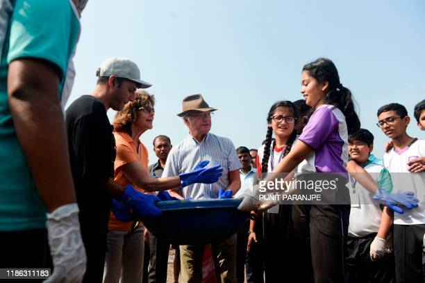 Sweden's King Carl XVI Gustaf and Queen Silvia participate in a beach cleanup project a the Versova Beach in Mumbai on December 4 2019