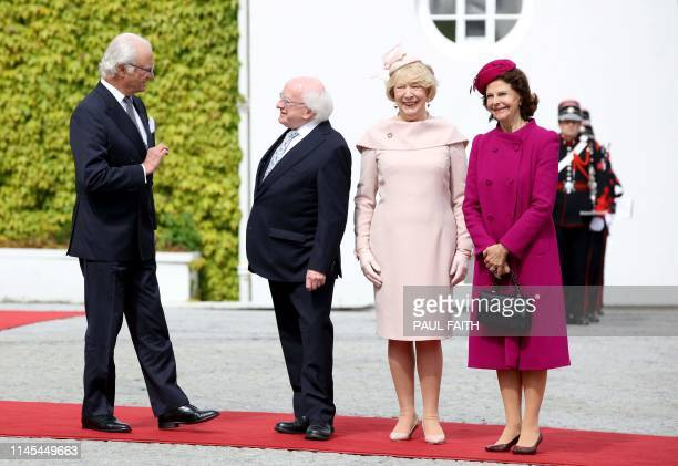 Sweden's King Carl XVI Gustaf and Queen Silvia pose for a photogaph after being greeted by Ireland's President Michael D Higgins and his wife Sabina...