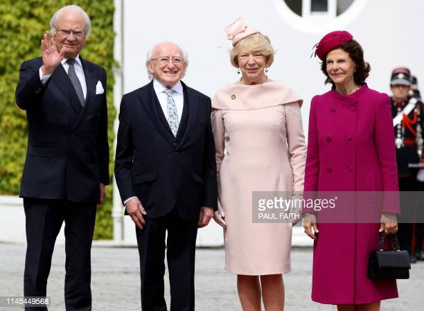 Sweden's King Carl XVI Gustaf and Queen Silvia pose for photogaphs after being greeted by Ireland's President Michael D Higgins and his wife Sabina...