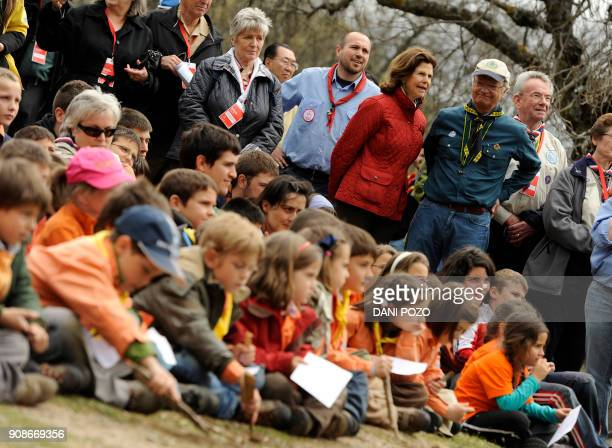 Sweden's King Carl XVI Gustaf and Queen Silvia take part in an event organised by the MadridMSC Scouts club to celebrate George's day in El Escorial...