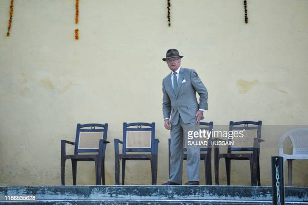 Sweden's King Carl XVI Gustaf arrives to attend a Ganga Arti Puja a prayer service on the banks of the Ganga river in Rishikesh on December 5 2019