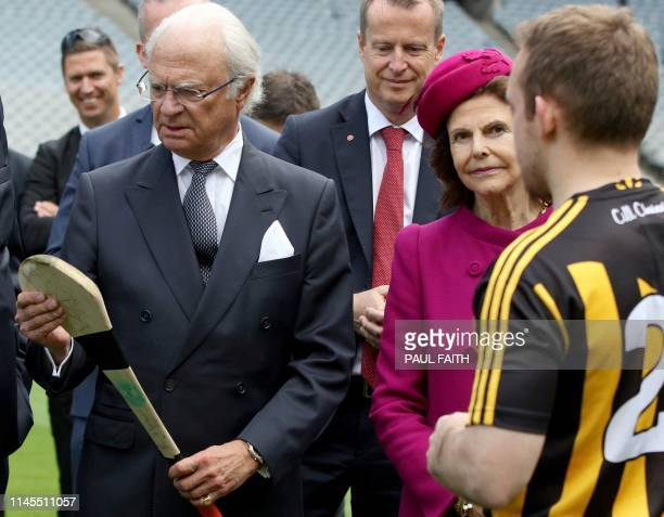Sweden's King Carl XVI Gustaf his wife Queen Silvia are shown a hurley stick or caman, during a hurling demonstration at Croke Park, the home of the...