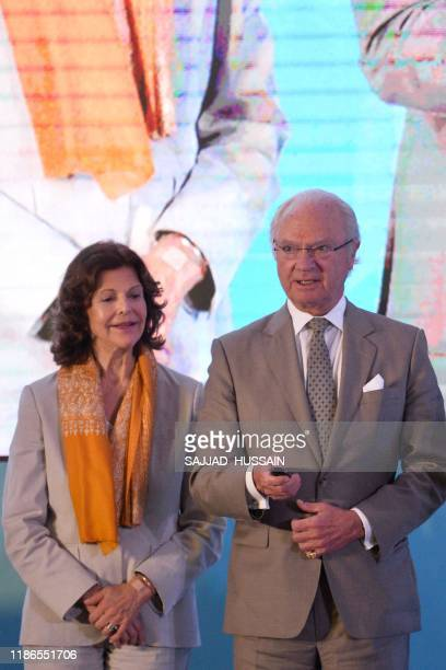 Sweden's King Carl XVI Gustaf inaugurates the Sarai sewage treatment plant as Queen Silvia looks on in Haridwar on December 5 2019