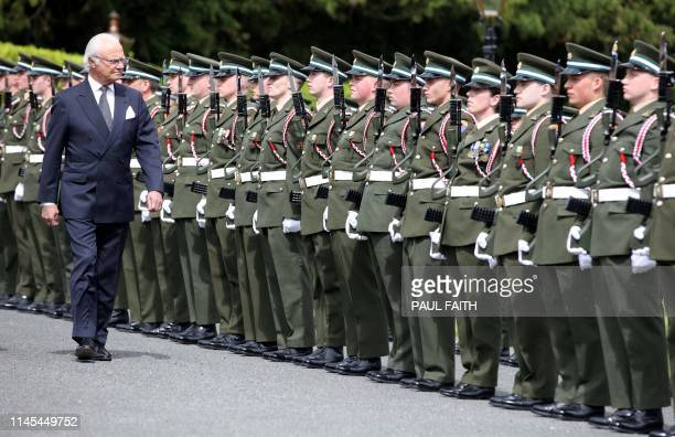 Sweden's King Carl XVI Gustaf inspects a guard of honour after being greeted by Ireland's President Michael D Higgins at Pheonix Park in Dublin on...