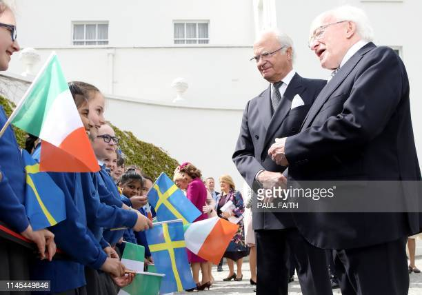 Sweden's King Carl XVI Gustaf is introduced by Ireland's President Michael D Higgins to local school children, after they arrived at Pheonix Park in...