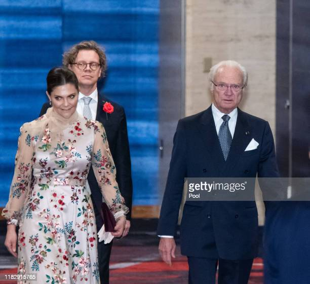 Sweden's King Carl XVI Gustaf left and Crown Princess Victoria arrive at the cocktail party before the banquet hosted by the Prime Minister of Japan...