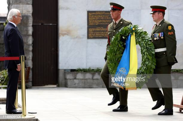 Sweden's King Carl XVI Gustaf prepares to lay a wreath in the Garden of Remembrance in Dublin on May 22 on the first day of a three-day State Visit...