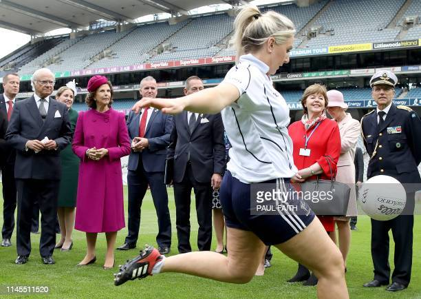 Sweden's King Carl XVI Gustaf reacts as he and his wife Queen Silvia watch a Gaelic football demonstration at Croke Park, the home of the Gaelic...
