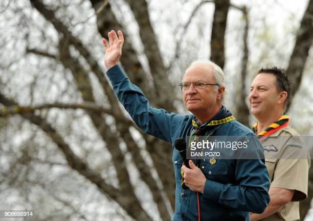 Sweden's King Carl XVI Gustaf takes part in an event organised by the MadridMSC Scouts club to celebrate George's day in El Escorial near Madrid on...