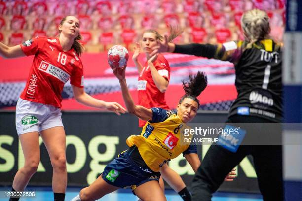 Sweden's Left back Jamina Roberts vies with Mette Denmark's Right back Mette Tranborg, Denmark's Right winger Andrea Ulrikka Aagot Hansen and...