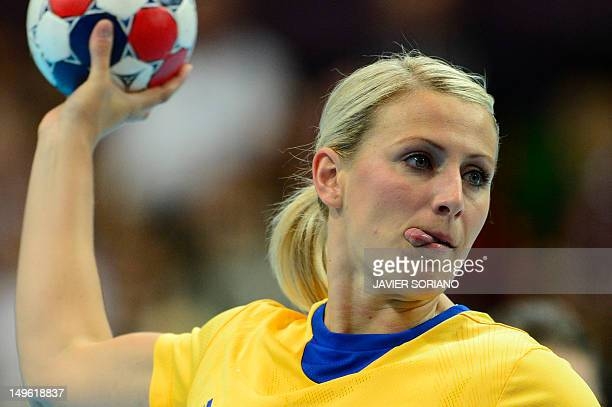 Sweden's leftback Johanna Ahlm prepares to shoot during the women's preliminaries Group A handball match France vs Sweden for the London 2012...