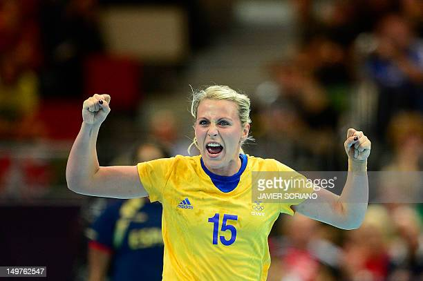 Sweden's leftback Johanna Ahlm reacts after a goal during the women's preliminary Group B handball match Spain vs Sweden for the London 2012 Olympics...
