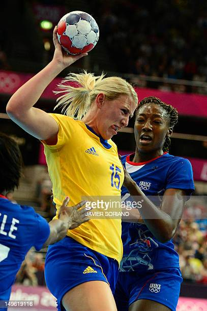 Sweden's leftback Johanna Ahlm vies with France's leftback Mariama Signate during the women's preliminaries Group A handball match France vs Sweden...