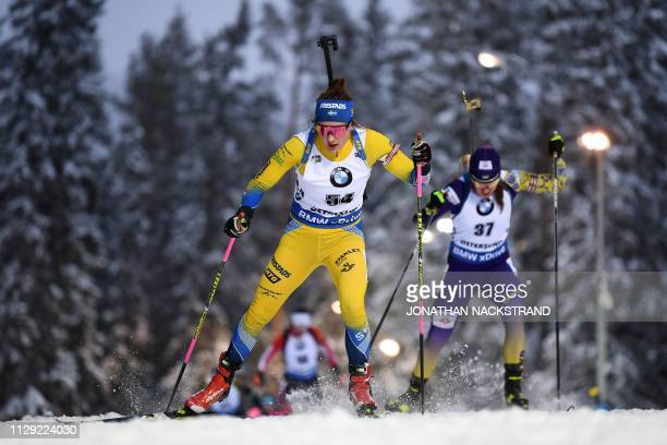 Sweden's Linn Persson and Ukraine's Yuliia Dzhima compete in the women's 75 km sprint event at the IBU Biathlon World Championships in Ostersund...