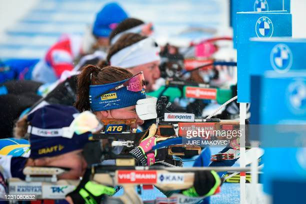 Sweden's Linna Persson competes at the shooting range in the 4x7,5 km Mixed Relay event at the IBU Biathlon World Championships in Pokljuka,...