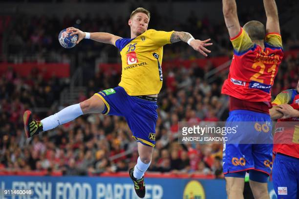 Sweden's Linus Arnesson jumps to shoot on goal despite Spain's Joan Canellas during the final match of the Men's 2018 EHF European Handball...