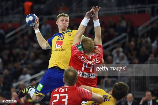 Sweden's Linus Arnesson throws the ball during the semifinal match of the Men's 2018 EHF European Handball Championship between Denmark and Sweden in...