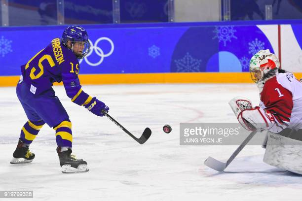 Sweden's Lisa Johansson scores against Japan's Nana Fujimoto in the women's classifications ice hockey match between Sweden and Japan during the...