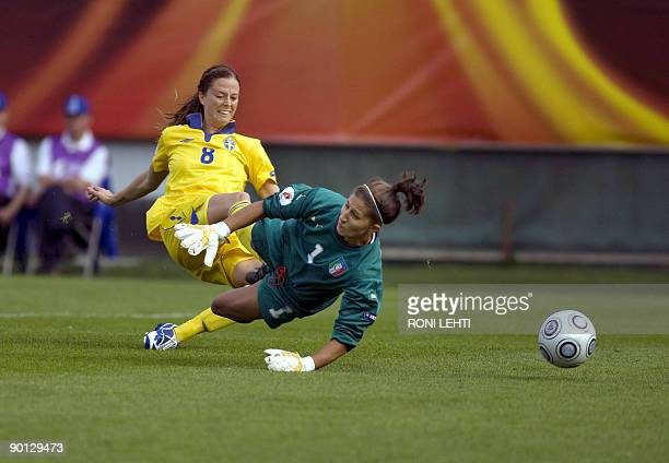 Sweden's Lotta Schelin shoots and scores past Italy's goalkeeper Anna Maria Picarelli during the UEFA women's Euro 2009 group C football match...