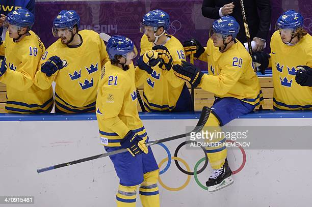 Sweden's Loui Eriksson celebrates with teammates after scoring during the Men's Ice Hockey Semifinal match between Sweden and Finland at the Bolshoy...