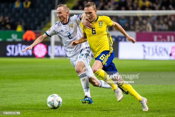 Sweden's Ludwig Augustinsson in a duel with Russia's Vladislav Ignatyev during the UEFA Nations League B group two match between Sweden and Russia at...