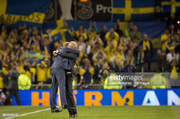 Sweden's manager Erik Hamren embraces his assistant coach Marcus Allback after winning the World Cup Qualifying Group C match at the Aviva Stadium...