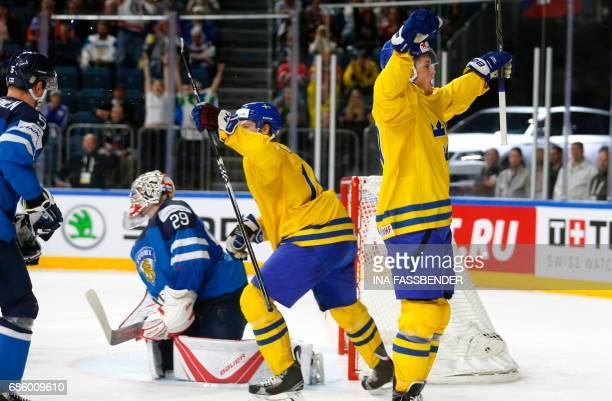 Sweden's Marcus Krueger and William Nylander celebrate a goal during the IIHF Men's World Championship Ice Hockey semi-final match between Sweden and...