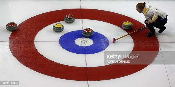 Sweden's Margaretha Sigfridsson lines up a stone during the women's curling round robin session 5 match between Switzerland and Sweden at the Ice...