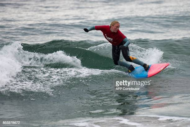 Sweden's Maria Petersson rides a wave to win the Lofoten Masters 2017 the northernmost surf contest in the world on September 23 2017 in Unstad's Bay...