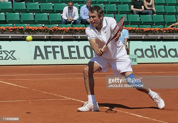 Sweden's Mats Wilander returns the ball as he plays with compatriot Mikael Pernfors vs US John McEnroe and Ecuador' Andres Gomez during legends over...