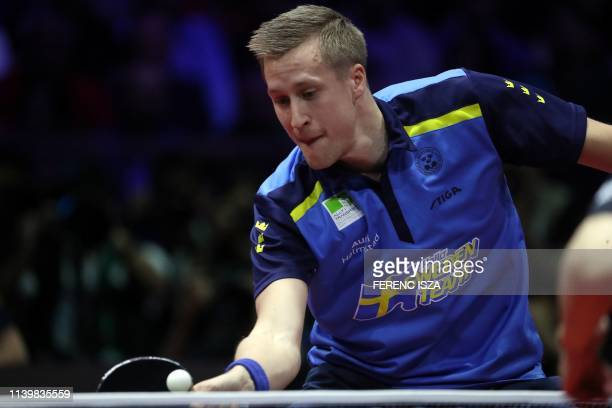 Sweden's Mattias Falck returns the ball to China's Ma Long on April 28, 2019 during their men's single final at the ITTF World Table Tennis...