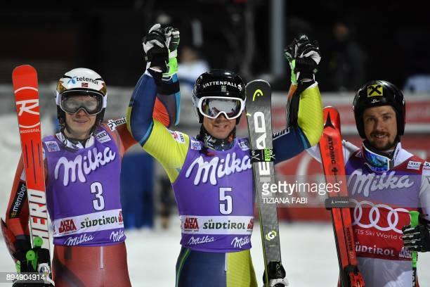Sweden's Matts Olsson winner celebrates with Norway's Henrik Kristoffersen second and Austria's Marcel Hirscher third after winning of the FIS Alpine...