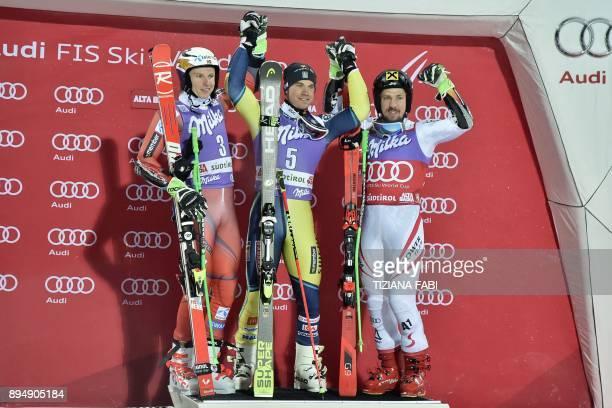 Sweden's Matts Olsson winner celebrates with Norway's Henrik Kristoffersen second and Austria's Marcel Hirscher third during the podium ceremony of...
