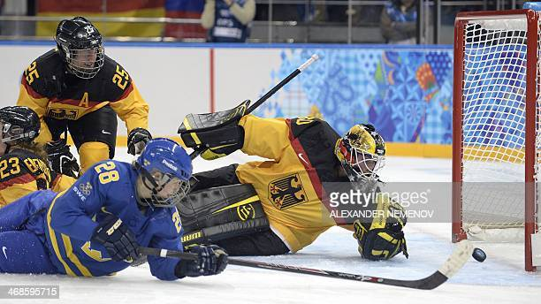 Sweden's Michelle Lowenhielm scores past Germany's goalkeeper Jennifer Harss during the Women's Ice Hockey Group B match Germany vs Sweden at the...