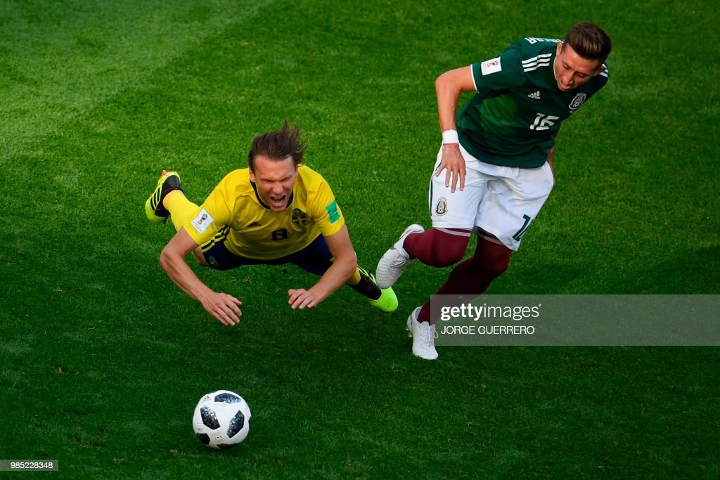 TOPSHOT - Sweden's midfielder Albin Ekdal (L) and Mexico's midfielder Hector Herrera vie for the ball during the Russia 2018 World Cup Group F football match between Mexico and Sweden at the Ekaterinburg Arena in Ekaterinburg on June 27, 2018. (Photo by JORGE GUERRERO / AFP) / RESTRICTED