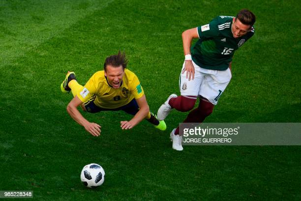 TOPSHOT Sweden's midfielder Albin Ekdal and Mexico's midfielder Hector Herrera vie for the ball during the Russia 2018 World Cup Group F football...