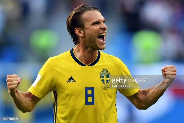 TOPSHOT Sweden's midfielder Albin Ekdal celebrates their victory at the end of the Russia 2018 World Cup round of 16 football match between Sweden...