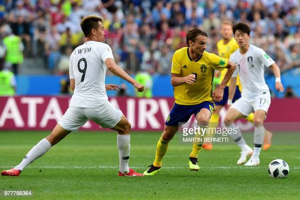 Sweden's midfielder Albin Ekdal dribbles past South Korea's forward Kim Shinwook during the Russia 2018 World Cup Group F football match between...