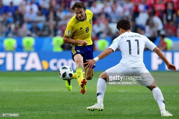 Sweden's midfielder Albin Ekdal passes the ball ahead of South Korea's forward Hwang Heechan during the Russia 2018 World Cup Group F football match...